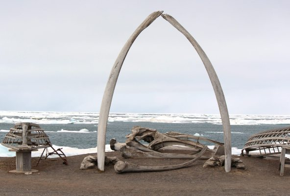 In this photo taken Monday, July 16, 2012, a whalebone arch sits on the Barrow, Alaska shoreline as ice floats in the Arctic Ocean beyond. The U.S. Coast Guard opened its search and rescue base at Barrow on Monday. (AP Photo/Kodiak Daily Mirror, Nicole Klauss)
